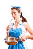 Girl in a blue apron Royalty Free Stock Photography