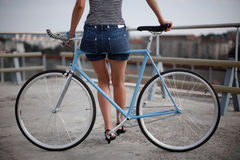 A girl with blue bike. A girl and fixed gear bicycle Stock Image