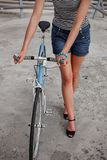 A girl with blue bike Stock Photos
