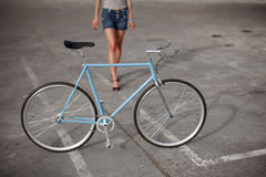 A girl with blue bike Stock Image