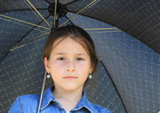 Girl in blue with black umbrella Royalty Free Stock Image