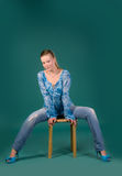 Girl in a blue blouse and jeans Stock Photography