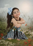 Girl with blue bow Stock Photography