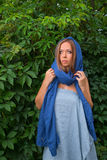 Girl in a blue cape Stock Photos
