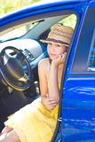 Girl in blue car Royalty Free Stock Images