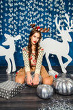 Girl in blue Christmas decorations Royalty Free Stock Photo