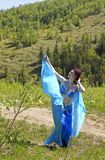 Girl in blue clothes east dance Royalty Free Stock Image