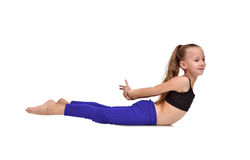 Girl in blue clothing doing yoga exercises Royalty Free Stock Photos