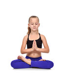 Girl in blue clothing sitting lotus position Royalty Free Stock Images
