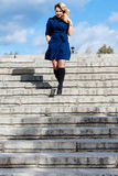 Girl in In Blue Coat On Stairs Royalty Free Stock Image