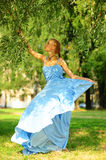Girl in blue dress Stock Photos