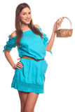 Girl in blue dress with basket isolate on hite background Royalty Free Stock Images