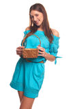 Girl in blue dress with basket isolate on hite background Stock Image