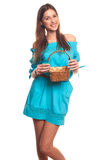 Girl in blue dress with basket isolate on hite background Stock Photos