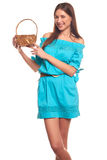 Girl in blue dress with basket isolate on hite background Stock Photography