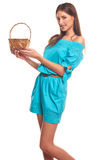 Girl in blue dress with basket isolate on hite background Royalty Free Stock Photography