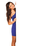 Girl in blue dress. Behind white wall Royalty Free Stock Image