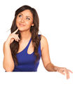 Girl in blue dress. Behind white wall Royalty Free Stock Photo