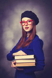 Girl in blue dress with books Royalty Free Stock Photo