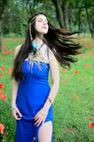 Girl with blue dress Royalty Free Stock Image