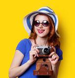 Girl in blue dress with camera Royalty Free Stock Image