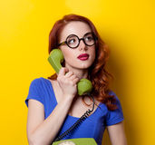 Girl in blue dress with dial phone Stock Photos
