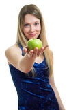 Girl in blue dress with a green apple Royalty Free Stock Photo