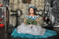 Girl in blue dress hold snowdrops Royalty Free Stock Photo