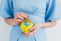 Girl in a blue dress holds an Easter cupcake. The concept of Easter baking and traditions. Toning. Selective focus Royalty Free Stock Photography