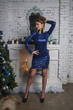 Girl in blue dress near christmas decorated tree Royalty Free Stock Photo