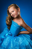 Girl in blue dress Stock Images