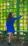 The girl in the blue dress photographed themselves on the phone sitting in the gazebo Royalty Free Stock Photos