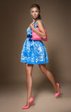 Girl in blue dress with pink bag Stock Image