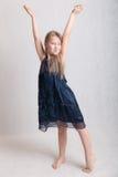 Girl in a blue dress Stock Photos