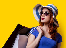 Girl in blue dress with shopping bags Stock Image