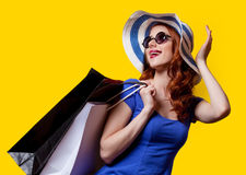 Girl in blue dress with shopping bags Royalty Free Stock Image