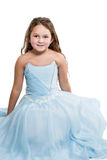 Girl in a blue dress sitting on the floor Royalty Free Stock Photography