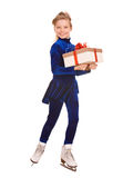 Girl in blue dress on skates with gift box. Stock Photography