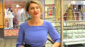 Girl in blue dress speaks to camera stock video