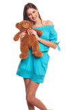 Girl in blue dress with teddy bear isolate on white background Royalty Free Stock Image