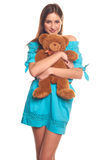 Girl in blue dress with teddy bear isolate on white background Stock Image