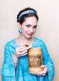 Girl in a blue dress with toes.the image of a Russian beauty royalty free stock image