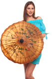 Girl in blue dress with umbrella isolate on white background Stock Images