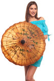 Girl in blue dress with umbrella isolate on white background Stock Photo
