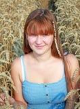 Girl in blue dress walking on wheat field Royalty Free Stock Photo