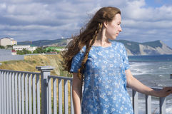 The girl in a blue dress Stock Images