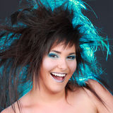 Girl with blue electric hair Stock Image