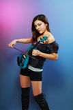 Girl with blue electric violin Stock Image