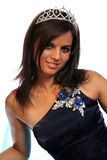 Girl in an blue evening dress and with a diadem Stock Photos