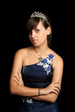 Girl in an blue evening dress and with a diadem stock images